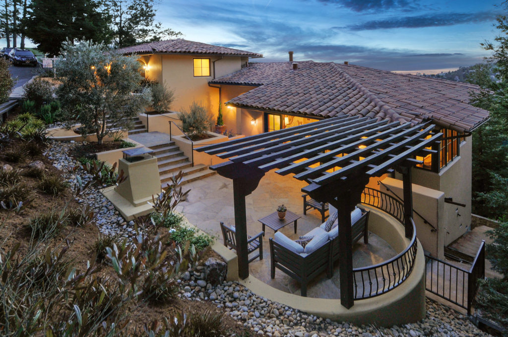 The Grubb Company home listing - Beautiful hillside home exterior at twilight